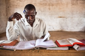 A man in a Bible school studies a passage of scripture.
